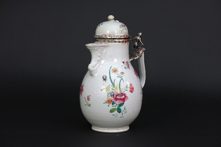 Mid 18th Cent. Chinese coffeepot in porcelain with a nice decor with flowers and insects and with European silver mounting-