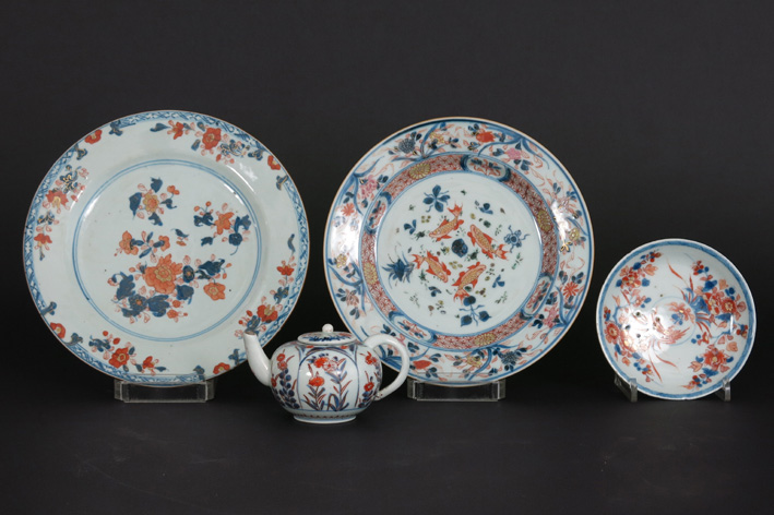 Four pieces of 18th Cent. Chinese porcelain: 2 plates, a saucer and a teapot-