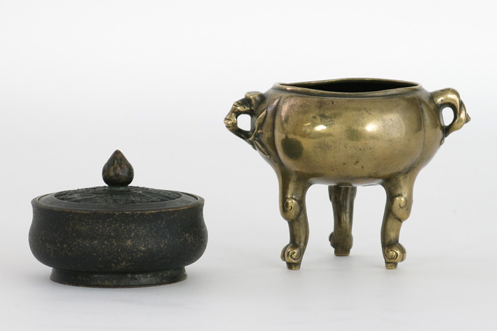 Two small Chinese incense burners in bronze, one with a marked lid and one on 3 feet-
