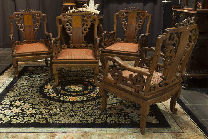 Set of 4 antique Chinese armchairs with typical carvings and back panels in rose-wood-