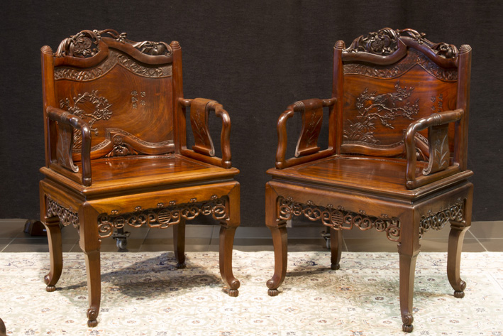 Pair of antique Chinese armchairs with fine carvings with bats, birds,... and Chinese characters-