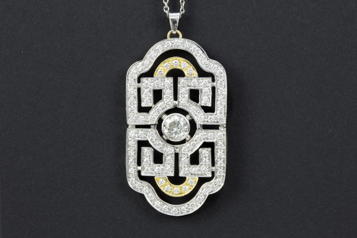 Pendant with an Art Deco-plaquette model in white and yellow gold (18 carat) with at least 3,20 carat of brilliants (the middle one weighing at least 1,20 carat)-