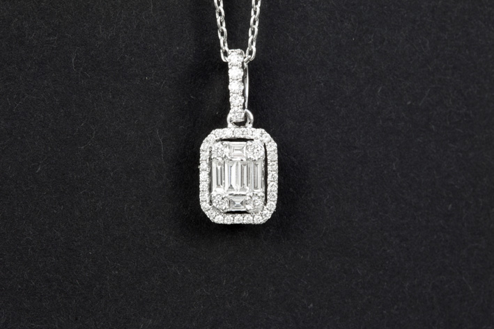 Matching pendant in white gold (18 carat) with at least 0,25 carat of very high quality brilliant in baguette and classic style-
