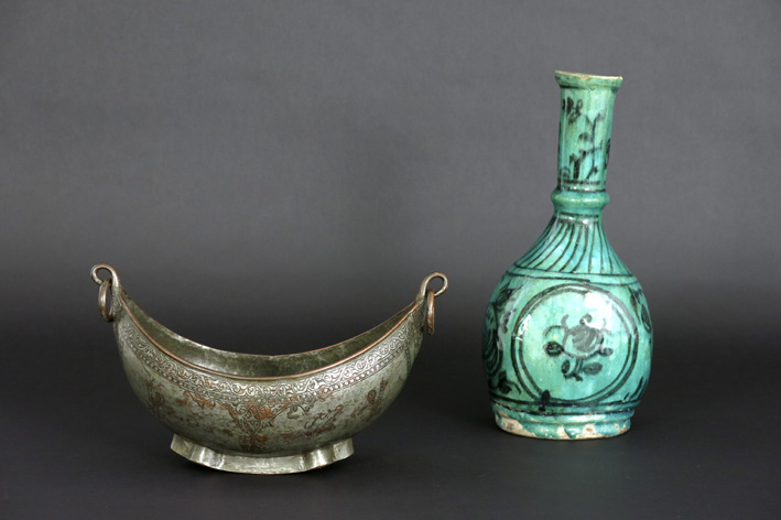 Two Persian items: a pipeholder in earthenware and a 'kashkoul'-