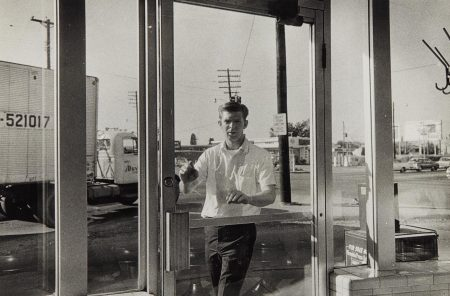 William Eggleston-Untitled (Young Man Entering Diner)-1968