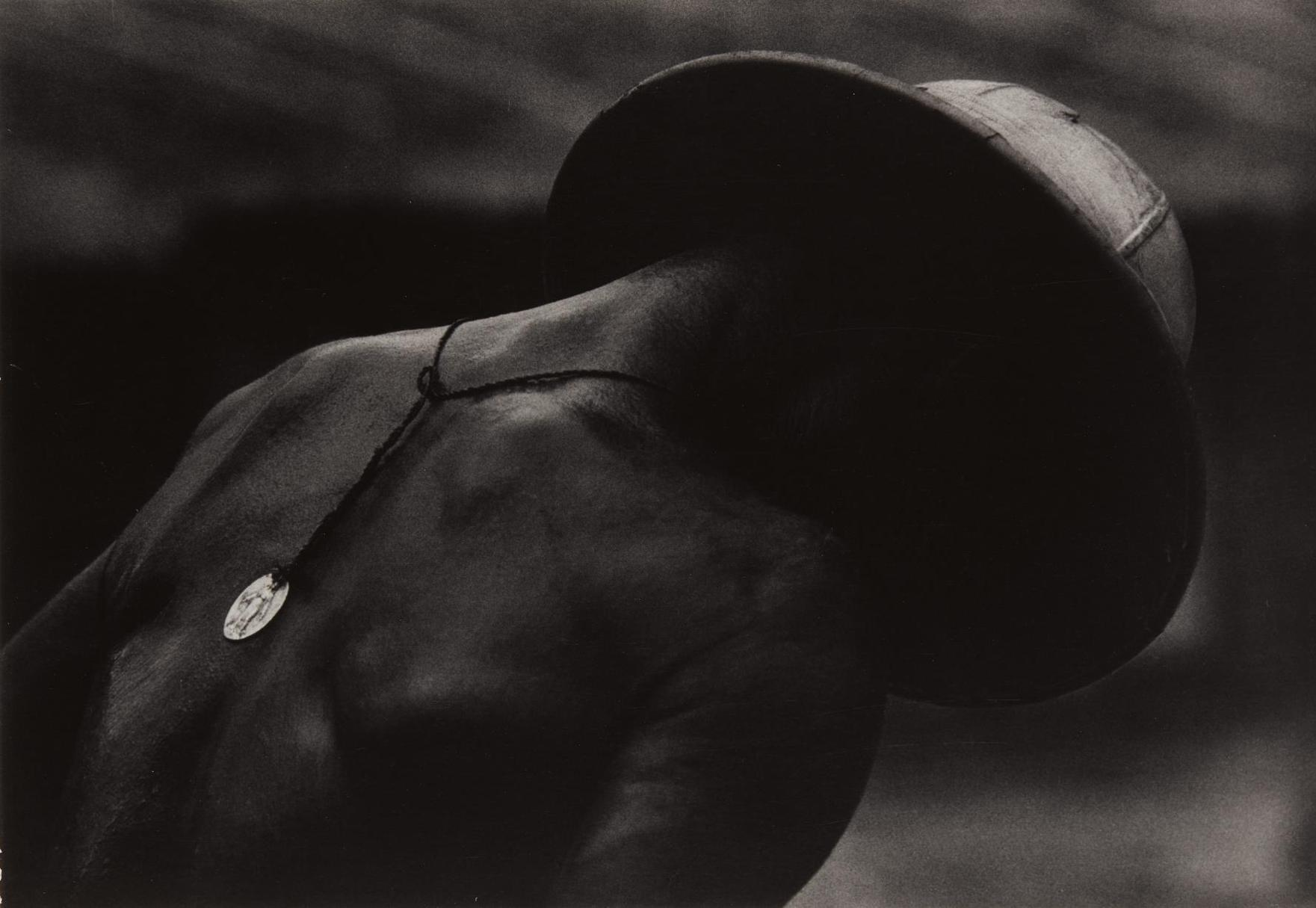 W. Eugene Smith-Leper Patient And Religious Medal From A Man Of Mercy-1954
