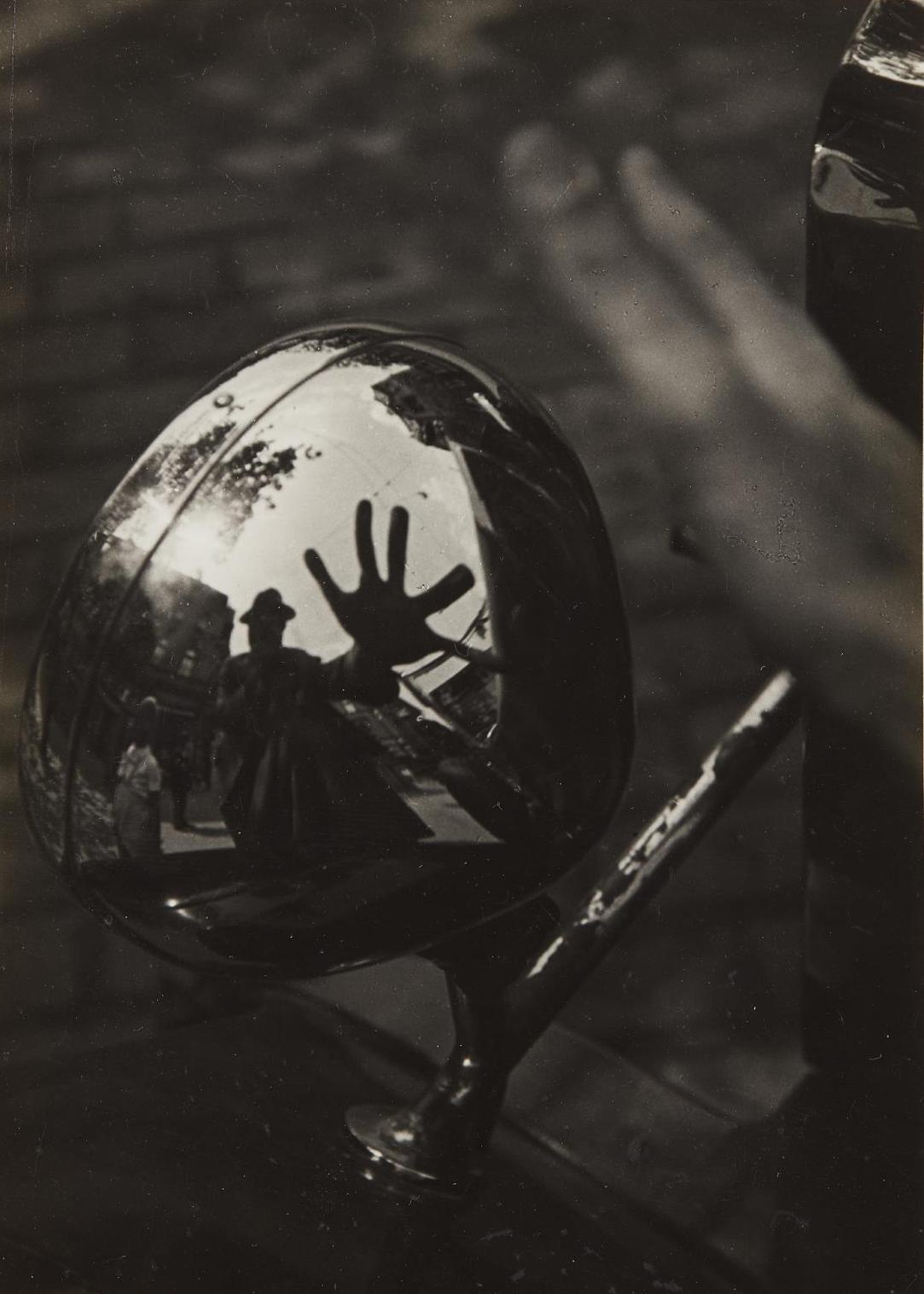 Imre Kinszki-Self-Portrait In Reflection Of Car Headlight-1934