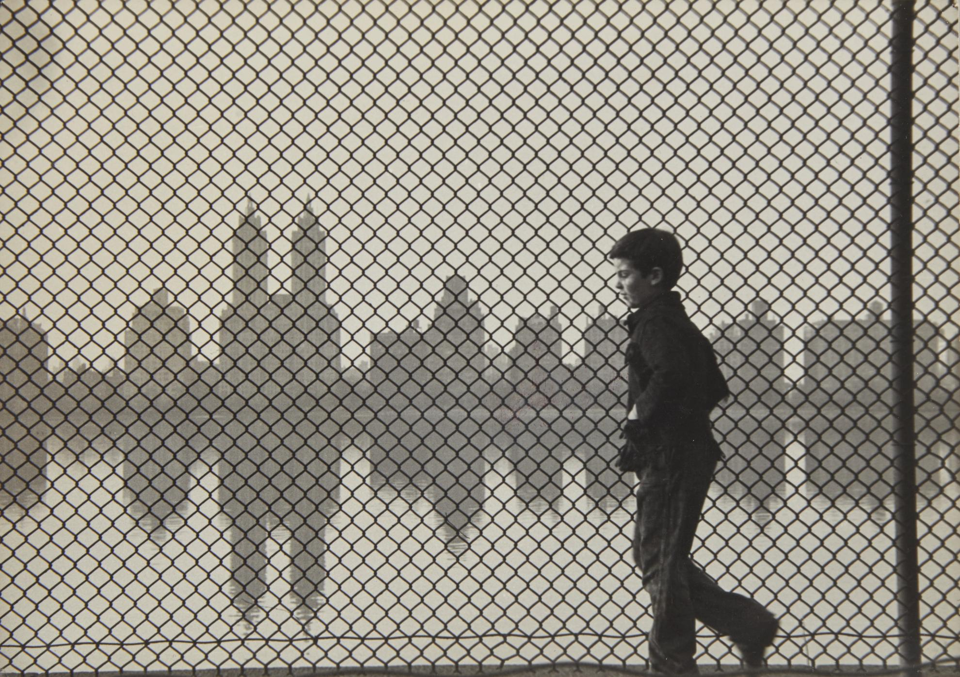 Ruth Orkin-Central Park Reservoir, Boy + Fence-1954