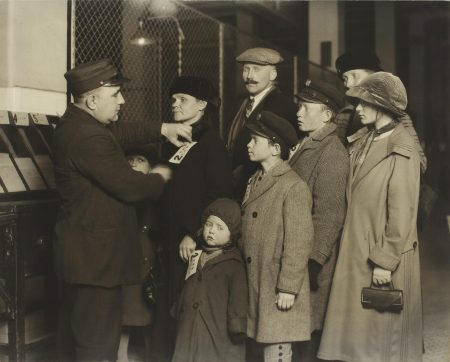 Lewis Wickes Hine-A Family At Ellis Island, New York Getting Tagged By An Official-1905