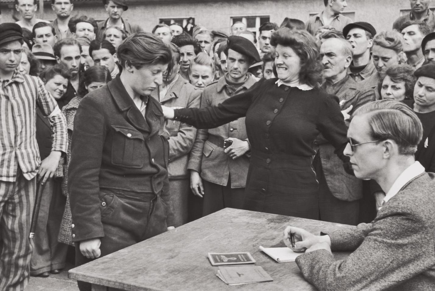 Henri Cartier-Bresson-Gestapo Informer Recognized By A Woman She Had Denounced, Transit Camp, Dessau, Germany-1945