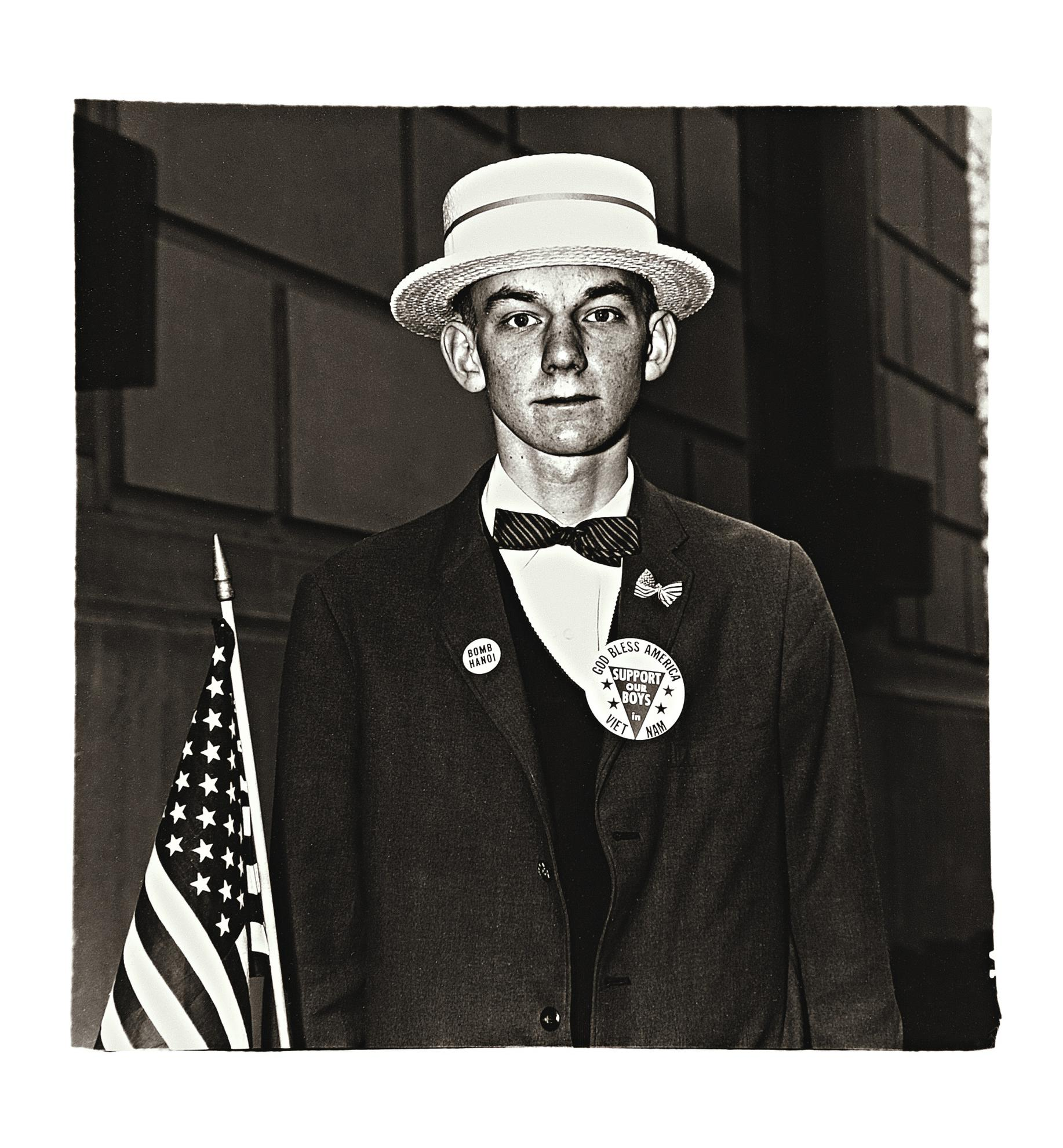 Diane Arbus-Boy In Straw Hat Waiting To March In A Pro-War Parade, N. Y. C.-1967