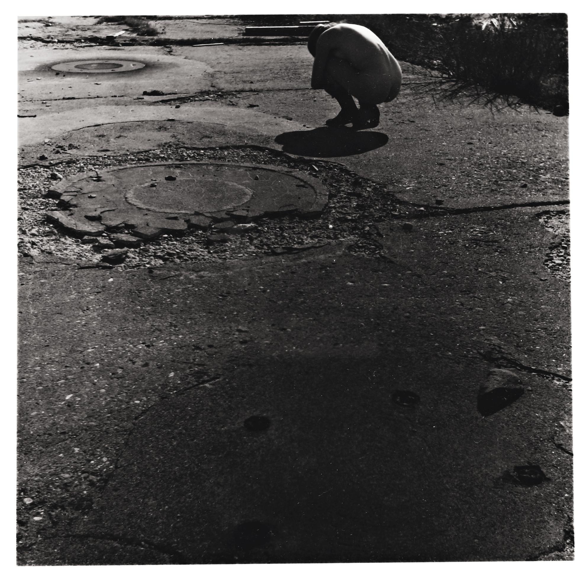 Francesca Woodman-Untitled, Providence, Rhode Island (Self-Portrait, Nude Crouching On Sidewalk)-1977