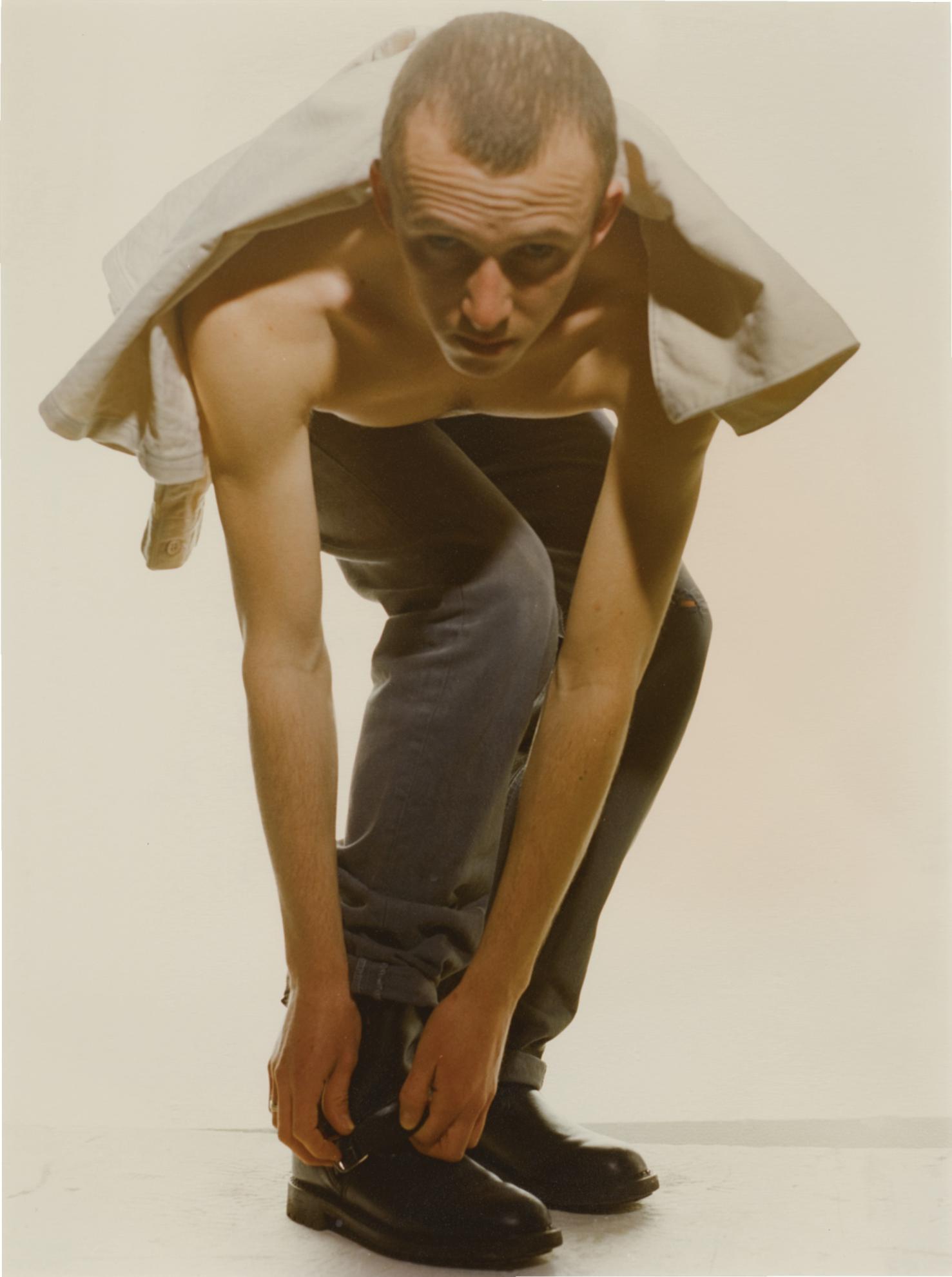 Wolfgang Tillmans-Adam Doing Up Boot-1991