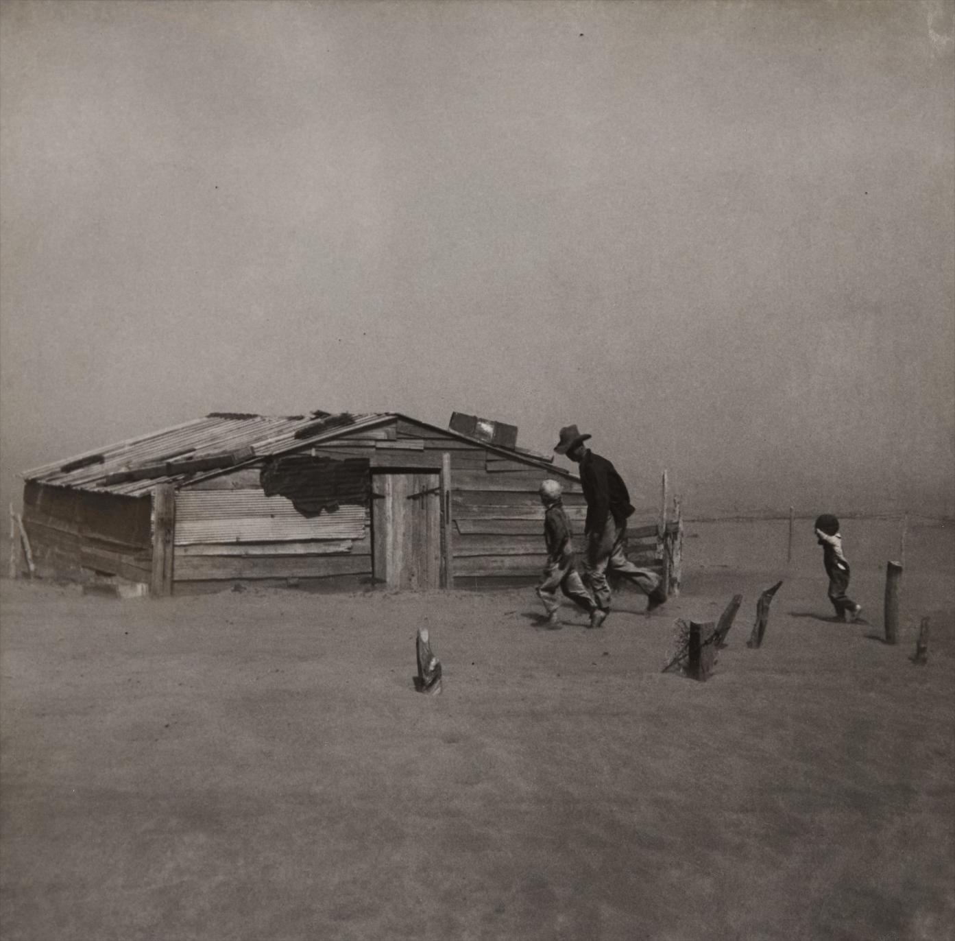 Arthur Rothstein - Farmer And Sons Walking In The Face Of A Dust Storm, Cimarron County, Oklahoma-1936