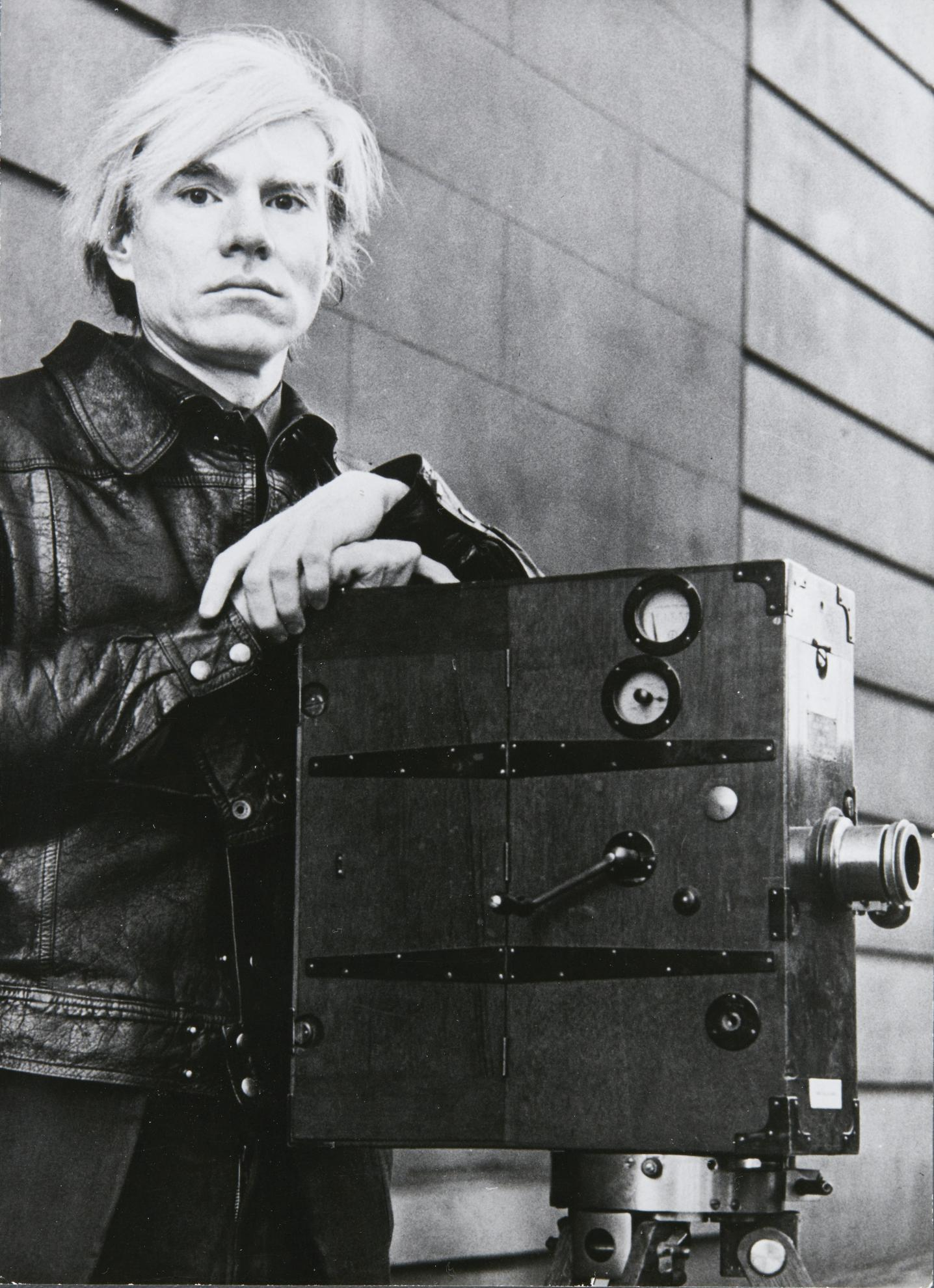 Andy Warhol-Self-Portrait (Andy Warhol With Film Camera Taken During The Heyday Of His Factory Films)-1977