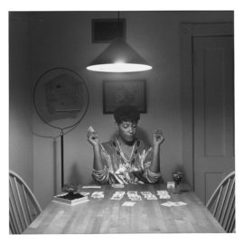 Carrie Mae Weems-Untitled (Woman Playing Solitaire From Kitchen Table Series)-1990