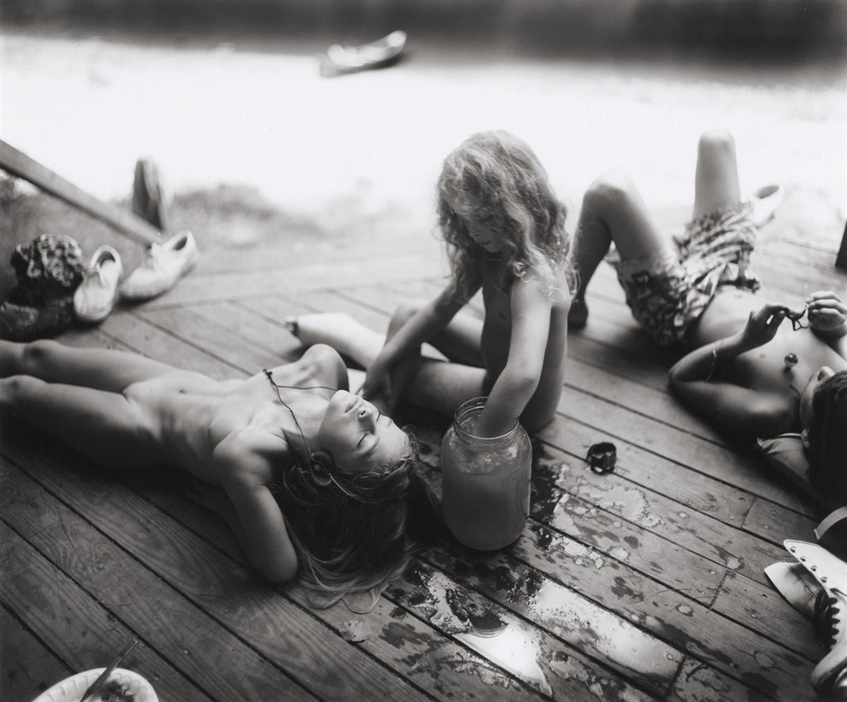 Sally Mann-Listening To Madonna By The Tadpole Jar-1990
