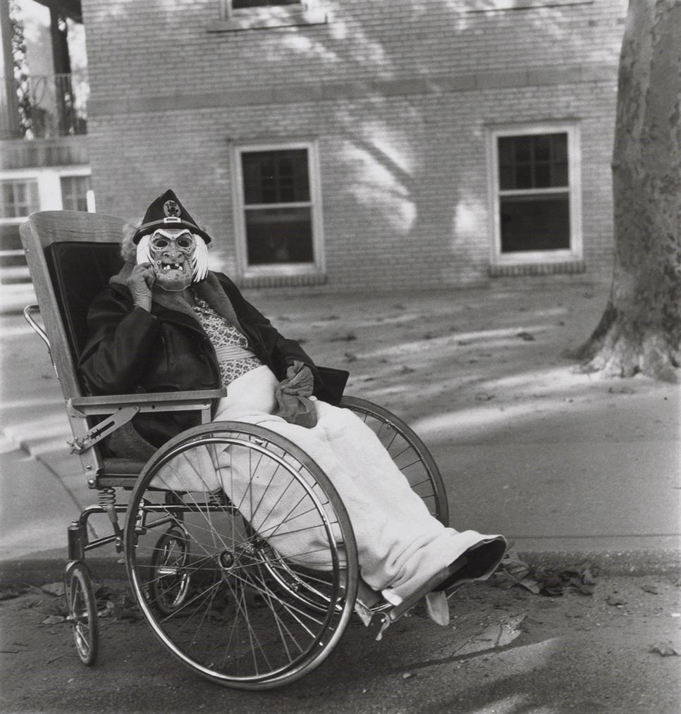 Diane Arbus-Masked Woman In A Wheelchair, Pa.-1970