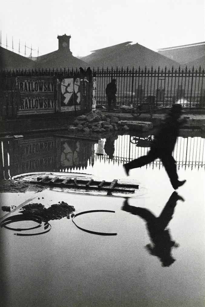Henri Cartier-Bresson-Behind The Gare St. Lazare, Paris-1932