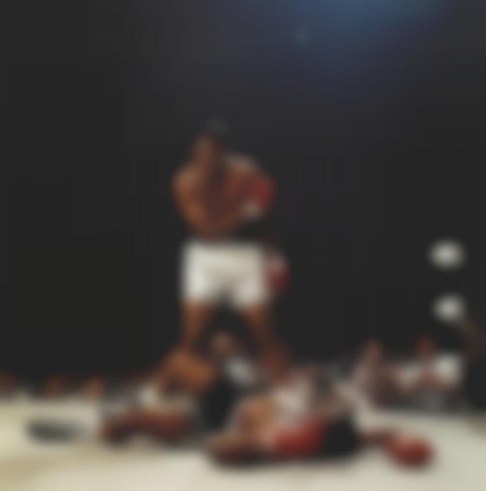 Neil Leifer-Muhammad Ali, First Round Knockout Of Sonny Liston, St. Dominics Arena, Lewiston, Maine, 1965-1965