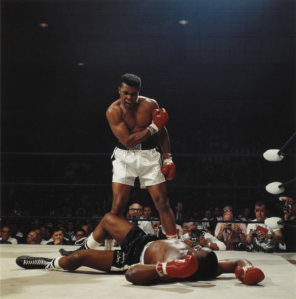 Neil Leifer-Muhammad Ali, First Round Knockout Of Sonny Liston, St. Dominics Arena, Lewiston, Maine, 1965-1965