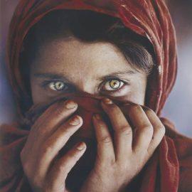 Steve McCurry-Afghan Girl With Hands On Face-1984
