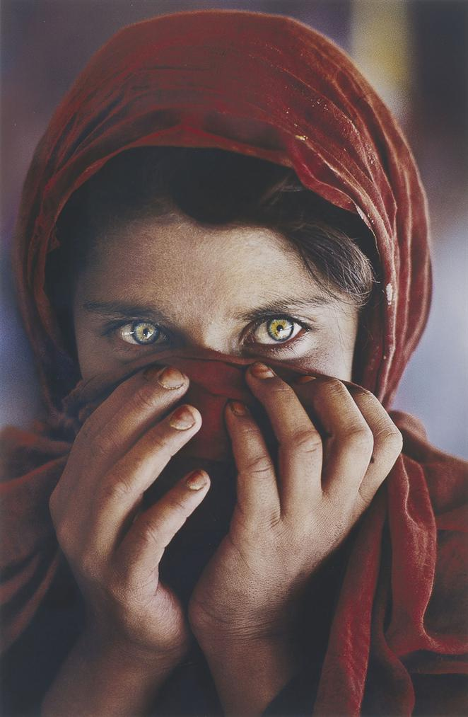Steve McCurry-Afghan Girl With Hands On Face-1984