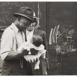 Helen Levitt-New York City (Man Holding Baby)-1939