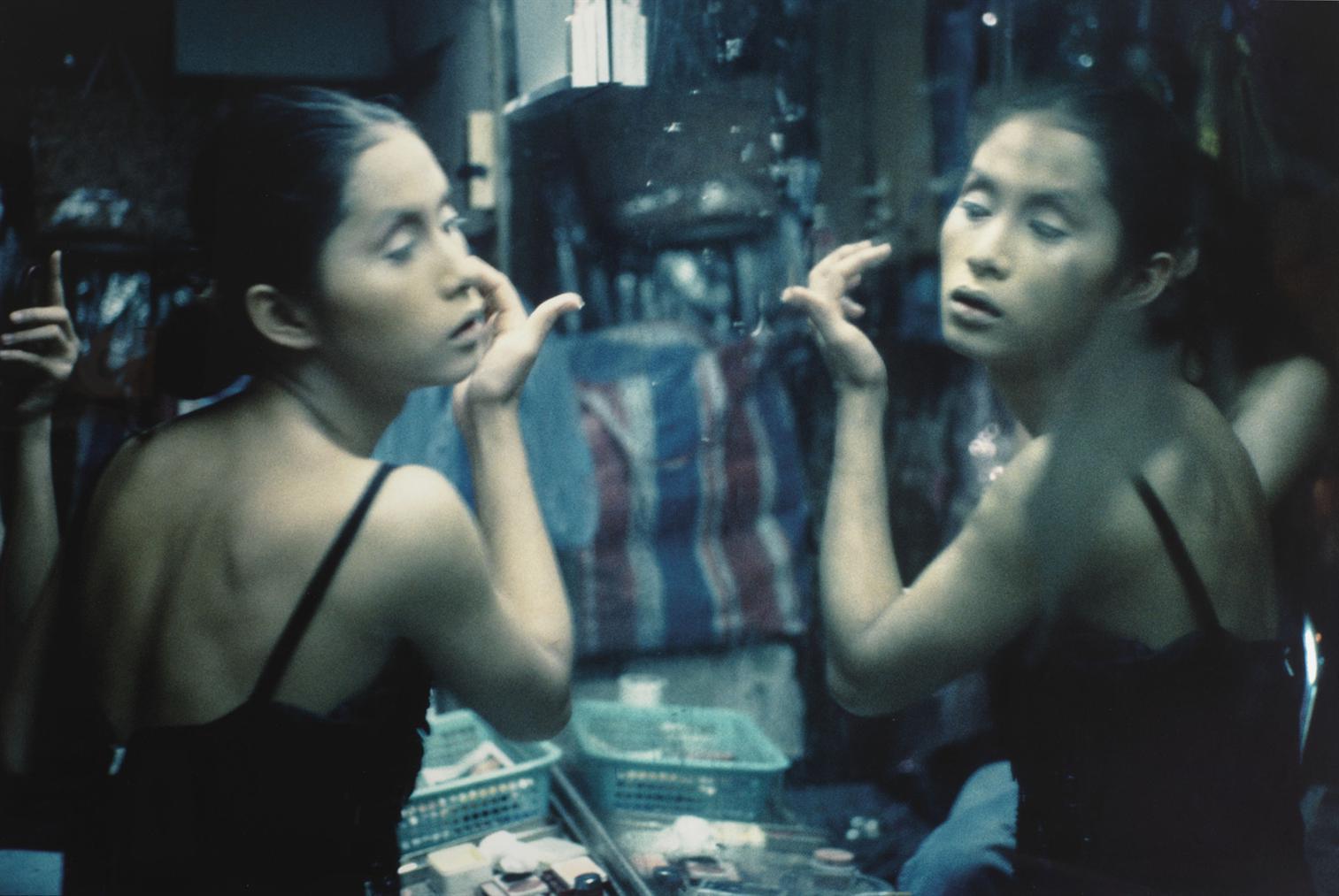 Nan Goldin-C. Putting On Her Make-Up At Second Tip, Bangkok-1992