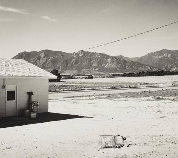 Robert Adams-Tract Home And Abandoned Shopping Cart. Colorado Springs, Colorado-1971