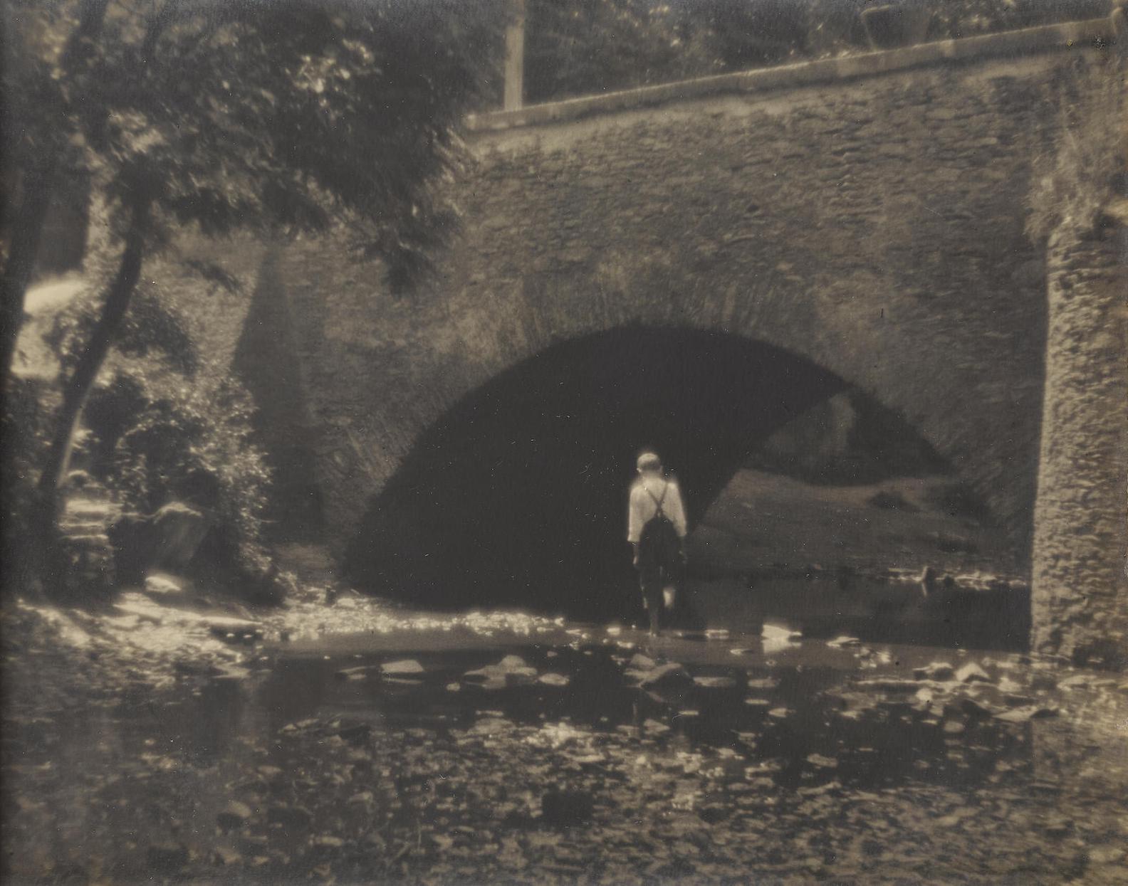 Josef Sudek-Untitled (Boy Crossing Stream)-1925