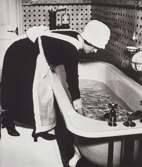 Bill Brandt-Parlourmaid Preparing A Bath Before Dinner, London-1939