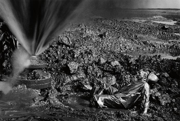 Sebastiao Salgado-Greater Buhrman Oil Field, Kuwait (Fallen Worker) / Man Lying in Oil-1991