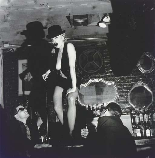 Helmut Newton-Madonna dancing on Bar with Beer Bottle, Hollywood-1990