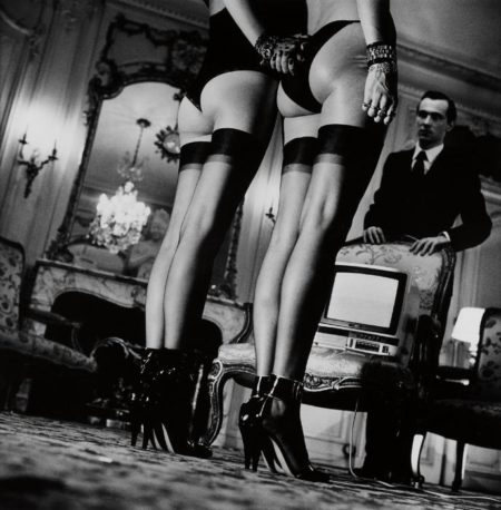 Helmut Newton-Two pairs of legs in silk stockings, Paris-1979