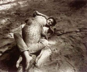 Helmut Newton-Lauren Hutton wrestling Alligator-1989