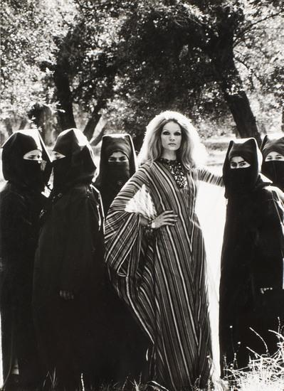 Helmut Newton-Making a hit in the harem-1970