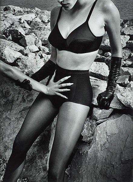 Helmut Newton-Wolfor Woman an Han on Boy-1995