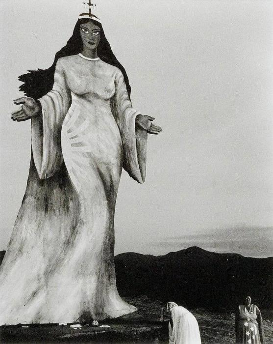 Sebastiao Salgado-Brasil 1980 (Two Women making an Offering to a Goddess Statue, Brazil)-1980