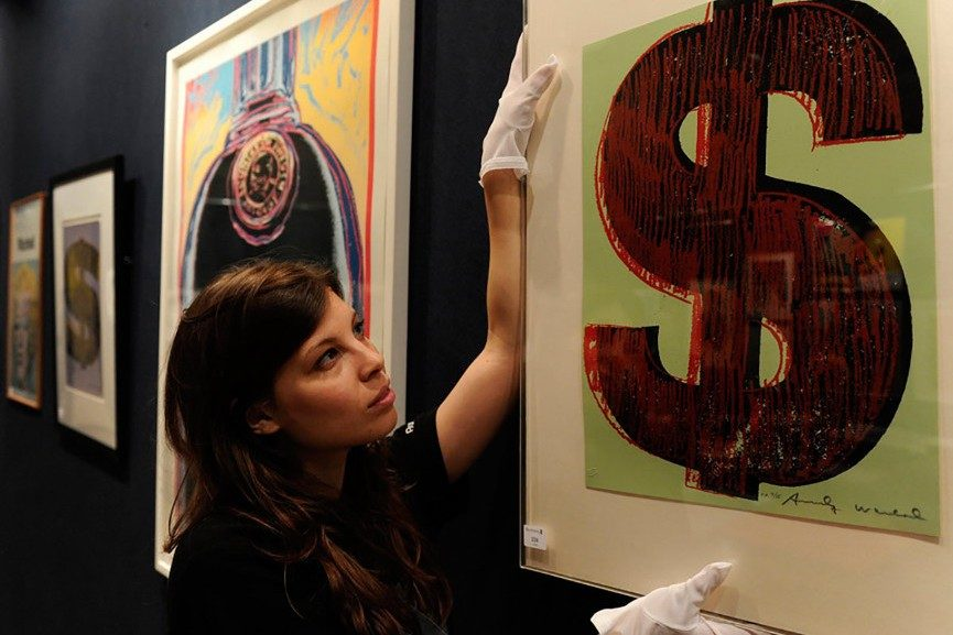 A Curator Placing a Piece On Display - Image via pinterestcom