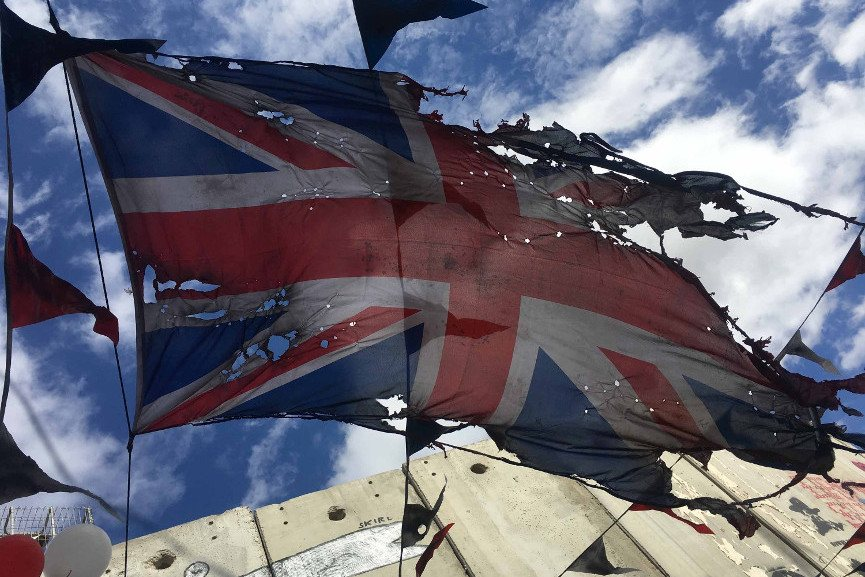 A Tattered Union Jack Flutters Outside Banksy's Walled Off Hotel - Image via KITVcom