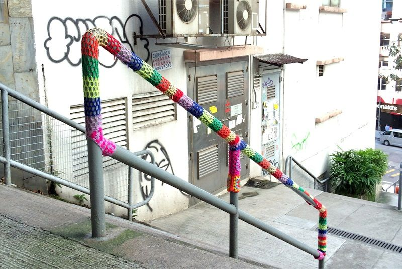 A handrail yarn bombed by Esther Poon, images via Sheep and Stitch