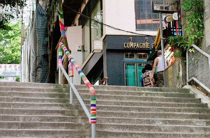 A yarn bombed handrail by Esther Poon, images via Sheep and Stitch