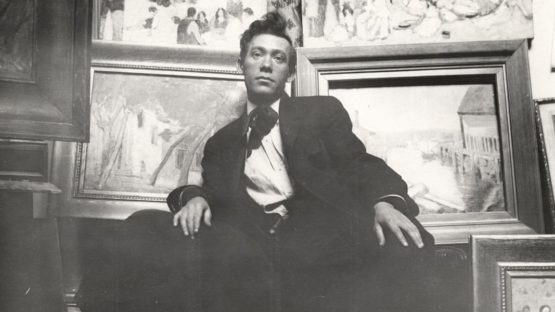 Abraham Walkowitz in his studio with paintings