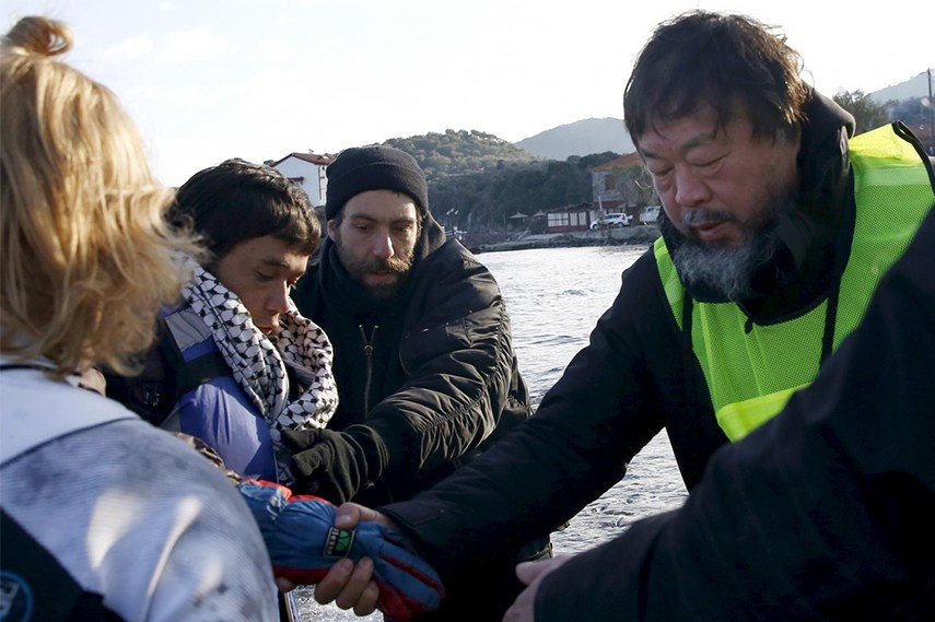 Ai Weiwei helping the newly-arrived refugees