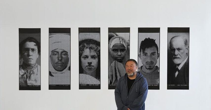 Ai Weiwei in front of the banners