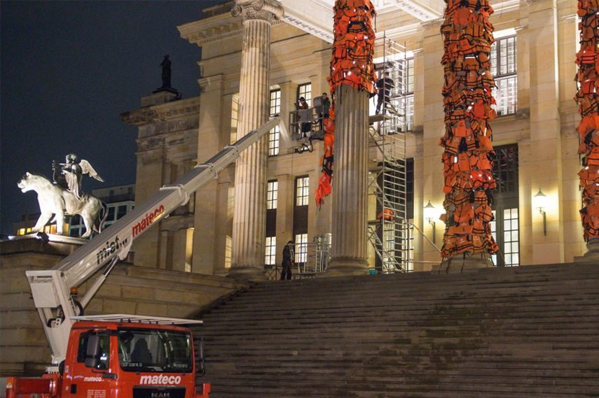 Ai Weiwei and his team working on his installation in Berlin