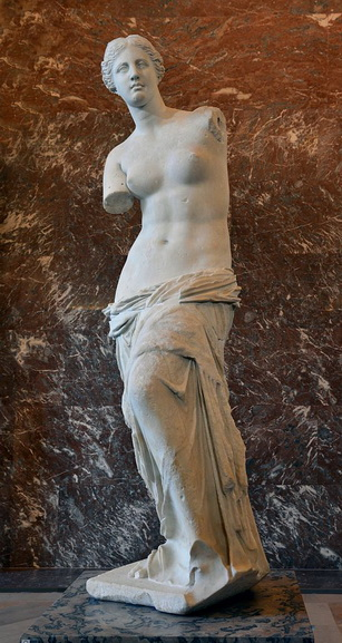 An ancient classical Greek history of Aphrodite statue of Hellenistic goddess Aphrodite Venus de Milo made by Alexandros of Antioch is located in Louvre museum