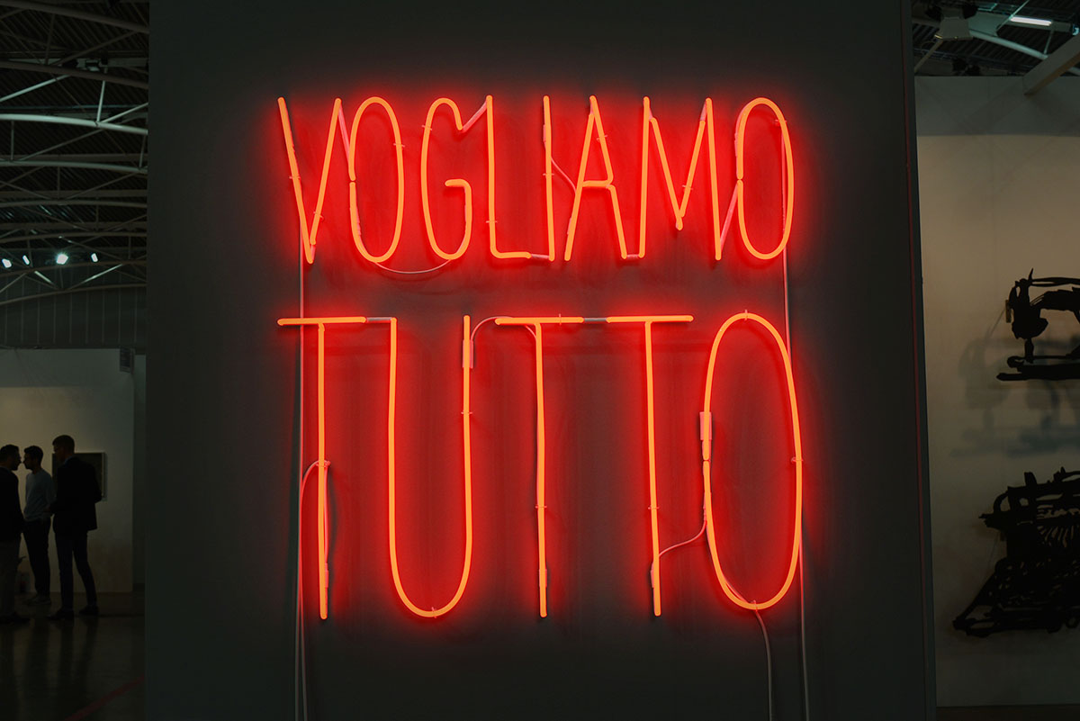 Alfredo Jaar - Vogliamo Tutto, 2016. Red neon mounted directly on the wall, 101,6 x 101,6 cm, 40 x 40 in. Courtesy Galleria Lia Rumma