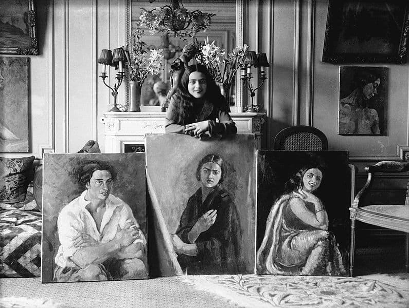 Amrita Sher-Gil with her paintings